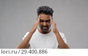 Купить «unhappy indian man suffering from headache», видеоролик № 29400886, снято 1 ноября 2018 г. (c) Syda Productions / Фотобанк Лори