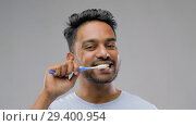 Купить «indian man with toothbrush cleaning teeth», видеоролик № 29400954, снято 1 ноября 2018 г. (c) Syda Productions / Фотобанк Лори