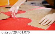 Купить «Young woman with arm prosthesis at sewing factory making sketches on the cloth. Hands in focus», видеоролик № 29401070, снято 20 ноября 2018 г. (c) Константин Шишкин / Фотобанк Лори