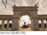 Купить «Astana, Kazakhstan - August 24, 2015: The area of Kazakhstan's independence, archway and monument Kazak Eli», фото № 29401182, снято 24 августа 2015 г. (c) Владимир Пойлов / Фотобанк Лори
