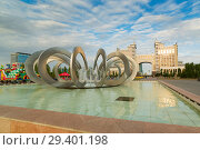 Купить «ASTANA, KAZAKHSTAN - August 25, 2015: Fountain Horseshoe and Wheel in Square of love», фото № 29401198, снято 25 августа 2015 г. (c) Владимир Пойлов / Фотобанк Лори