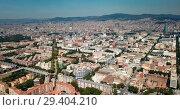Купить «Aerial view of cityscape of Barcelona, Eixample district and Mediterranean coastline», видеоролик № 29404210, снято 24 июля 2018 г. (c) Яков Филимонов / Фотобанк Лори