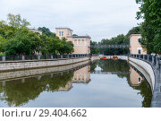 Yauza river with two sluices of Syromyatnicheskiy waterworks against the cityscape in Moscow. Стоковое фото, фотограф Mikhail Starodubov / Фотобанк Лори