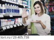 Купить «Girl customer looking for effective deodorant in supermarket», фото № 29405738, снято 23 ноября 2016 г. (c) Яков Филимонов / Фотобанк Лори