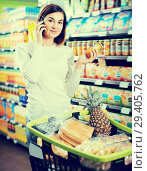Купить «Ordinary female talking on phone about shopping», фото № 29405762, снято 23 ноября 2016 г. (c) Яков Филимонов / Фотобанк Лори