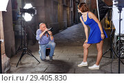 Купить «Photographer shooting female model on city street», фото № 29405830, снято 5 октября 2018 г. (c) Яков Филимонов / Фотобанк Лори