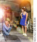 Купить «Photographer shooting female model on city street», фото № 29405834, снято 5 октября 2018 г. (c) Яков Филимонов / Фотобанк Лори