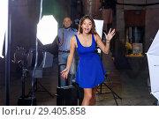 Купить «Young attractive woman delighted with professional photo shooting on town street with male photographer», фото № 29405858, снято 5 октября 2018 г. (c) Яков Филимонов / Фотобанк Лори