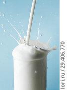 Купить «Splash of milk in glass», фото № 29406770, снято 14 февраля 2015 г. (c) Иван Михайлов / Фотобанк Лори