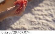 Купить «happy smiling girl enjoying the sunset, eating watermelon, sit on salt, close-up», видеоролик № 29407074, снято 10 ноября 2018 г. (c) Ирина Мойсеева / Фотобанк Лори