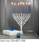 Купить «The Religious symbols of Jewish holiday Hanukkah», фото № 29407198, снято 10 ноября 2018 г. (c) Константин Сенявский / Фотобанк Лори