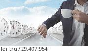 Купить «Businessman looking at watch with time clocks on surreal road», фото № 29407954, снято 19 января 2019 г. (c) Wavebreak Media / Фотобанк Лори