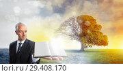 Купить «Man holding book with magical surreal seasonal tree imagination», фото № 29408170, снято 19 января 2019 г. (c) Wavebreak Media / Фотобанк Лори