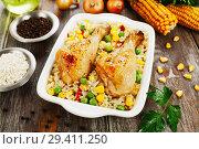 Купить «Chicken legs baked with rice and vegetables», фото № 29411250, снято 5 марта 2018 г. (c) Надежда Мишкова / Фотобанк Лори