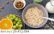 Купить «healthy breakfast of oatmeal and other food», видеоролик № 29412094, снято 2 ноября 2018 г. (c) Syda Productions / Фотобанк Лори