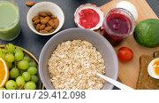 Купить «healthy breakfast of oatmeal and other food», видеоролик № 29412098, снято 2 ноября 2018 г. (c) Syda Productions / Фотобанк Лори