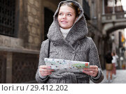 Купить «cheerful girl with map in coat hood», фото № 29412202, снято 11 ноября 2017 г. (c) Яков Филимонов / Фотобанк Лори