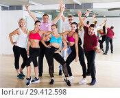 Купить «Modern males and females dancing excited posing», фото № 29412598, снято 9 октября 2017 г. (c) Яков Филимонов / Фотобанк Лори