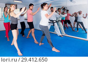 Купить «Adults trying new martial moves at karate class», фото № 29412650, снято 8 апреля 2017 г. (c) Яков Филимонов / Фотобанк Лори