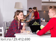 Купить «Girl discussing with guy in kitchen of hostel», фото № 29412690, снято 22 марта 2018 г. (c) Яков Филимонов / Фотобанк Лори
