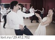 Купить «People practicing twist movements», фото № 29412702, снято 24 мая 2017 г. (c) Яков Филимонов / Фотобанк Лори