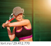 Купить «Woman wearing cap playing tennis», фото № 29412770, снято 19 июля 2017 г. (c) katalinks / Фотобанк Лори