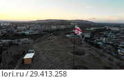 Купить «Flag on the mountain Gori city in Georgia Stalin's homeland 4K drone flight», видеоролик № 29413258, снято 6 ноября 2018 г. (c) Aleksejs Bergmanis / Фотобанк Лори