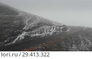 Купить «Mountain road in Georgia going to the pass in bad weather in fog and snow», видеоролик № 29413322, снято 6 ноября 2018 г. (c) Aleksejs Bergmanis / Фотобанк Лори