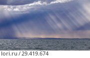 Купить «Rain and the sun's rays through the dramatic clouds in the sky over mongolian lake Durgen Nuur in Mongolia.», видеоролик № 29419674, снято 15 июля 2018 г. (c) Serg Zastavkin / Фотобанк Лори