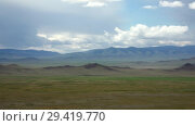 Купить «Panorama of natural mongolian grasslands surrounded by mountains in the North Mongolia», видеоролик № 29419770, снято 16 июля 2018 г. (c) Serg Zastavkin / Фотобанк Лори