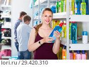Купить «woman choosing detergent at a household goods in the store», фото № 29420310, снято 13 апреля 2017 г. (c) Яков Филимонов / Фотобанк Лори