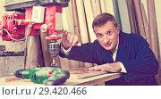 Купить «Man operating automatic screwdriver in wood workshop», фото № 29420466, снято 22 января 2019 г. (c) Яков Филимонов / Фотобанк Лори