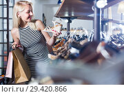 Купить «girl choosing pair of shoes in store», фото № 29420866, снято 9 декабря 2018 г. (c) Яков Филимонов / Фотобанк Лори