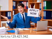 Купить «Young employee working in the office», фото № 29421342, снято 9 августа 2018 г. (c) Elnur / Фотобанк Лори