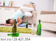 Купить «Young drunk handsome man after party at home», фото № 29421354, снято 9 июля 2018 г. (c) Elnur / Фотобанк Лори