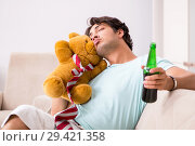 Купить «Young drunk handsome man after party at home», фото № 29421358, снято 9 июля 2018 г. (c) Elnur / Фотобанк Лори