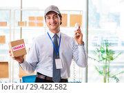 Купить «Male employee working in box delivery relocation service», фото № 29422582, снято 24 июля 2018 г. (c) Elnur / Фотобанк Лори