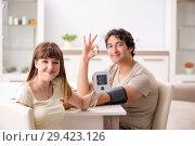 Купить «Wife checking husband's blood pressure», фото № 29423126, снято 27 июля 2018 г. (c) Elnur / Фотобанк Лори