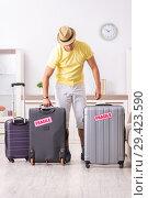 Купить «Man going on vacation with fragile suitcases», фото № 29423590, снято 4 июля 2018 г. (c) Elnur / Фотобанк Лори