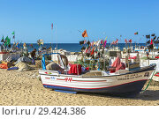 Купить «Fishing floats and flags set out to dry in the sun at Monte Gordo beach, Algarve, Portugal.», фото № 29424386, снято 7 октября 2018 г. (c) age Fotostock / Фотобанк Лори