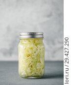 Sauerkraut in open glass jar, copy space. Стоковое фото, фотограф Ольга Сергеева / Фотобанк Лори