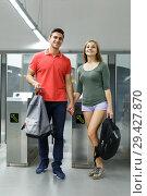 Купить «Couple is standing near turnstiles and moving around the city», фото № 29427870, снято 14 июня 2018 г. (c) Яков Филимонов / Фотобанк Лори