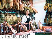 Купить «Worker selling Spanish jamon», фото № 29427954, снято 19 апреля 2019 г. (c) Яков Филимонов / Фотобанк Лори