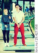 Купить «Golf players at golf course», фото № 29427958, снято 27 мая 2020 г. (c) Яков Филимонов / Фотобанк Лори