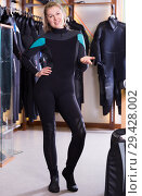Купить «woman is standing in diving costume», фото № 29428002, снято 25 января 2018 г. (c) Яков Филимонов / Фотобанк Лори