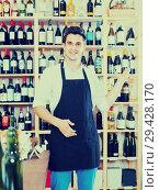 Купить «seller standing in alcohol section», фото № 29428170, снято 5 июня 2020 г. (c) Яков Филимонов / Фотобанк Лори