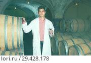 Купить «taster of winery with wine in cellar», фото № 29428178, снято 21 сентября 2016 г. (c) Яков Филимонов / Фотобанк Лори