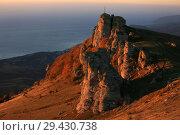 Купить «Beautiful view of the Demerdzhi mountains at sunrise against the backdrop of the sea in the fall in Crimea», фото № 29430738, снято 13 октября 2018 г. (c) Яна Королёва / Фотобанк Лори