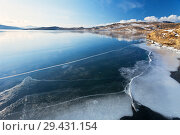 Lake Baikal in December. Freezing-over in shallow bays on a sunny cold day. Beautiful winter landscape. Стоковое фото, фотограф Виктория Катьянова / Фотобанк Лори