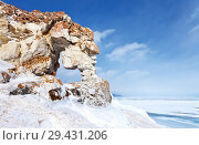 Lake Baikal in winter. Small Sea Strait. Terrain Kurma. Famous tourist stone arch in the cliffs of Cape Tsagan-Khushun - a natural landmark. Стоковое фото, фотограф Виктория Катьянова / Фотобанк Лори